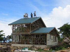Roof goes on - post cyclone repairs- the tree on the right fell on the previous house.